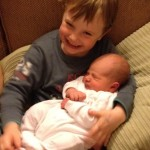 Big brother Tom with hypnobrithing baby Ned